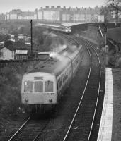 101 317 passes Meadowbank Stadium Halt on the Abbeyhill Loop as a HST approaches. Services diverted for ECML electrification in 1987.<br> <br> <br><br>[Bill Roberton&nbsp;//1987]