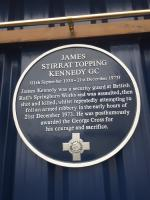 The text of a plaque unveiled to the memory of James Kennedy.<br><br> <br><br> James Stirrat Topping Kennedy GC (11th September 1930 - 21st December 1973)<br><br> <br><br> James Kennedy was a security guard at British Rail's Springburn Works and was assaulted, then shot and killed, whilst repeatedly attempting to foil an armed robbery in the early hours of 21st Devember 1973. He was posthumously awarded the George Cross for his courage and sacrifice.<br> <br><br>[John Yellowlees&nbsp;21/12/2017]