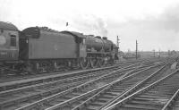 Royal Scot no 46121 <I>Highland Light Infantry, City of Glasgow Regiment</I>, with a summer Saturday through service, south of Carlisle on 4 August 1962. The train is the 11.50am from Glasgow Central to Manchester and Morecambe.<br><br>[K A Gray&nbsp;04/08/1962]