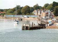Peaceful scene at Lymington Pier on 26 July 2002, with a train at the platform awaiting its departure time on the shuttle service to Brockenhurst.<br><br>[Ian Dinmore&nbsp;26/07/2002]