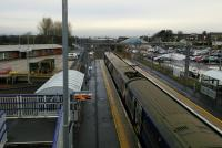 Looking west from the footbridge at Bathgate on 19th December 2017 as a Milngavie<br> service is about to depart. The depot is on the left.<br> <br> <br><br>[David Panton&nbsp;19/12/2017]