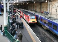 The Virgin Trains East Coast 0755 ex-Inverness <I>Highland Chieftain</I> running into platform 2 at Waverley on 21 December 2017. Standing alongside at the east end of platform 1 is the 1142 ScotRail service to North Berwick. <br><br>[John Furnevel&nbsp;21/12/2017]