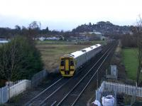 ScotRail 158782 passes Stirling's former St. Ninian's (Millhall Road) crossing which had, until relatively recently, the dubious honour of being regarded as Scotland's highest risk pedestrian level crossing. View is north from the new footbridge completed during 2017.<br><br>[Colin McDonald&nbsp;31/12/2017]
