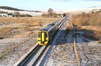 ScotRail 158782, forming the 1259 Tweedbank - Edinburgh, about to run through the site of Heriot station on 27 December 2017. Signs of the previous days snowfall are still very much in evidence.<br><br>[John Furnevel&nbsp;27/12/2017]