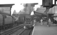 A recent arrival stands at Carlisle platform 3 in the summer of 1960 behind Britannia Pacific 70044 <I>Earl Haig</I>.<br><br>[K A Gray&nbsp;//1960]