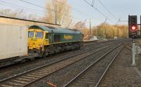 Freightliner 66551 rolls a Daventry to Mossend intermodal service through the Down Fast line at Lancaster station on 13th November 2017. <br><br>[Mark Bartlett&nbsp;13/11/2017]