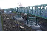 View north east of part of the temporary pedestrian and services bridge which has been erected alongside the A905 Kerse Road overbridge. Revised plans have now been approved for the work as part of the preparation for electrification. <br> <br> <br> <br><br>[Colin McDonald&nbsp;31/12/2017]