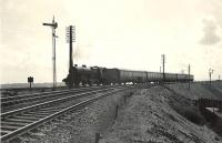 Looking south east towards Byrehill Junction on 4 April 1959 as <I>Crab</I> 2-6-0 42808 takes the route north towards Kilwinning with a train from Ayr to Glasgow St Enoch. <br><br>[G H Robin collection by courtesy of the Mitchell Library, Glasgow 04/04/1959]
