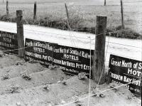 Multiple hotel signs for Cruden Bay Hotel seen at Inverurie in 1961. 'Great North of Scotland Railway - Hotels - Cruden Bay Hotel Port-Errol - Golf Course One of the Finest in Scotland'.<br><br>[David Murray-Smith&nbsp;/06/1961]