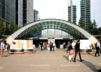 Entrance to Canary Wharf station on the London Underground Jubilee Line extension, opened in 1999. View east on a pleasant summer afternoon in July 2005, with the former West India Dock behind the camera. [See image 5217]<br><br>[John Furnevel&nbsp;22/07/2005]