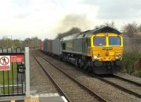The driver of this Southbound freight had to take it easy around the curve in the background, but now has the hammer down, as I believe those American truck driver chappies say. Loco is Freightliner 66570, looking towards Nuneaton. [Ref query 11 January 2018] <br><br>[Ken Strachan 08/04/2016]