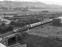 47461 <I>Charles Rennie Mackintosh</I> about to cross over the Edinburgh Suburban line with a WCML portion from Carstairs in 1982.  Beyond is the civil engineers depot. [Ref query 14 January 2017]<br> <br><br>[Bill Roberton&nbsp;//1982]