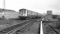 Carlisle bound Derby DMU passing Busby Junction in 1974. The unit is a Carlisle based set, with bars over the drop lights for working over the Cumbrian Coast line with its restricted clearances. The signal box at Busby Junction had been recently decommissioned. <br> <br><br>[Ian Millar //1974]