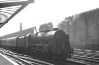 Royal Scot 4-6-0 46128 <I>The Lovat Scouts</I> stands in the west sidings alongside Carlisle platform 1 on a bright and sunny 31 August 1964 with the 10.30am Perth parcels.<br><br>[K A Gray&nbsp;31/08/1964]