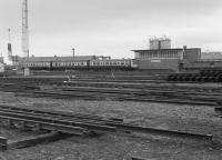 A 3-car Derby DMU passes Slateford Junction signalbox in 1982.  In the foreground is the civil engineers yard.  The 'box had closed the previous year but was retained as a training centre.<br> <br><br>[Bill Roberton&nbsp;//1982]