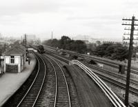 The view east from the footbridge of Balgreen Halt on the Corstorphine branch, with the main Edinburgh and Glasgow Railway to the right.<br><br>[David Murray-Smith 14/08/1961]