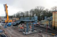 The footbridge for the new third platform at Kirkham being installed, with the help of a huge Ainscough crane, on 18th January 2018. The main bridge span was installed that same evening but the station is scheduled to reopen for Blackpool South line services on 29th January 2018 so there is still plenty for the <I>Orange Army</I> to do. [See image 59693] taken six months earlier showing the transformation of this location. <br><br>[Mark Bartlett&nbsp;18/01/2018]