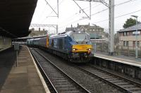 Another Class 68 <I>Cumbrian Coast</I> crew training run from Carlisle arrives in Carnforth on 19th January 2018. 68029 has just two coaches and 68003 <I>Astute</I> in tow and is signalled into the loops for a lunchtime break before the return run. <br><br>[Mark Bartlett&nbsp;19/01/2018]