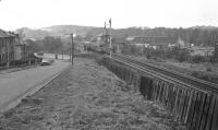 A Cravens DMU passing Pollokshaws North signal box, decommissioned, at the bridge over Haggs Road in 1974.<br><br>[Ian Millar&nbsp;//1974]