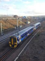 158713, on the 1422hrs Waverley to Tweedbank service, after passing Newcraighall on 15th January 2018. Beyond is the new EMU depot, complete with electric train.<br> <br> <br><br>[John Yellowlees&nbsp;15/01/2018]