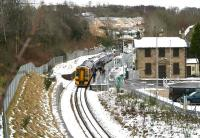 Despite the morning chill in the air, the early signs of a thaw are apparent around Gorebridge station on 21 January 2018, as the 0945 (Sunday) ex-Tweedbank picks up a fair number of Edinburgh bound passengers.<br><br>[John Furnevel&nbsp;21/01/2018]