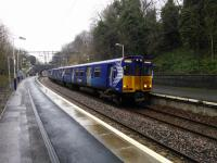 A Newton to Glasgow 314 EMU service calls at Kirkhill on the wet Saurday afternoon<br> of 13th January 2018. I think Kirkhill can be considered the posh end of<br> Cambuslang.<br> <br> <br><br>[David Panton&nbsp;13/01/2018]