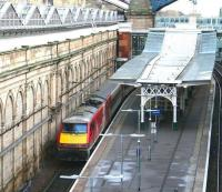 View east from Waverley Bridge over the sub platforms on 21 December 2017. Recently arrived at platform 9 is the Virgin Trains East Coast 0645 ex-Kings Cross. Note the way train and platform start to curve to the right to avoid the pier supporting the North Bridge.<br><br>[John Furnevel&nbsp;21/12/2017]