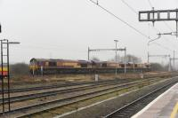 66's still dominate on freight at Didcot, although apparently GBRf are taking over some DB EWS turns. 66108, 66103 and 66030, running light from Acton to Hinksey (Oxford), pass through on a murky 20th January 2018.<br> <br> <br><br>[Peter Todd 20/01/2018]