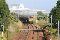 Torness Nuclear Power Station dominates the background as a Hunterston – Drax coal train rounds the curve north of Cockburspath on a fine day in the summer of 2007.<br><br>[John Furnevel&nbsp;30/06/2007]