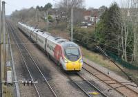 <I>Silver is so yesterday - unfortunately</I>. 390010 <I>Cumbrian Spirit</I>, one of a growing number of all white Pendolinos, runs south alongside the Oxheys Loop near Preston with a Glasgow to Euston service on 22nd January 2018. <br><br>[Mark Bartlett&nbsp;22/01/2018]