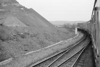 A northbound class 47-hauled train passes the points for Clatchard Craig quarry siding in 1985.<br> <br> <br><br>[Bill Roberton&nbsp;//1985]