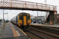 156448, working from Barrow to Carlisle, stands alongside one of the original Harrington Humps at the station of the same name. Still not exactly <I>level access</I> but much easier to get in at the rear door than the others. 13th November 2017. <br><br>[Mark Bartlett&nbsp;13/11/2017]