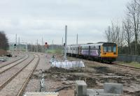 The view east from the original island platform at Kirkham on 30th January 2018. Work is still in progress but services to Blackpool South had resumed the previous day. A Pacer/Sprinter combination arrives from Preston in the branch platform. The Down Blackpool North line is on the left along with the new Up line.<br><br>[Mark Bartlett&nbsp;30/01/2018]