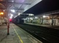 Just one passenger is visible on Kemble station on the 3rd of January 2015. View looks South East.<br><br>[Ken Strachan&nbsp;03/01/2015]