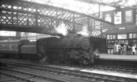 One of Kingmoor shed's Ivatt class 4MT 2-6-0s, no 43000, standing alongside platform 4 at Carlisle on 11 April 1964. The locomotive has recently arrived with the 10.48am Saturday morning local service from Langholm.<br><br>[K A Gray&nbsp;11/04/1964]