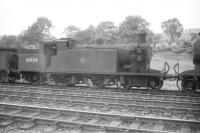 C16 4-4-2T no 67489 languishes in the sidings at Hawick in the summer of 1958.<br><br>[Robin Barbour Collection (Courtesy Bruce McCartney)&nbsp;10/08/1958]