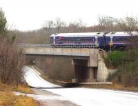 ScotRail 158739 crossing a deserted A7 as it approaches the Gorebridge stop on a grey and overcast first day of February 2018. The train is the 1154 Edinburgh - Tweedbank.<br><br>[John Furnevel&nbsp;01/02/2018]