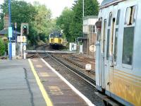 Comings and goings at the north end of Brockenhurst station in the summer of 2002, with trains about to pass over Lymington Road level crossing.<br><br>[Ian Dinmore&nbsp;26/07/2002]
