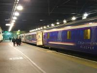 The Lowland Caledonian Sleeper, hauled by 92043, photographed soon after arrival at Euston in February 2018. The new Mark 5 Sleeper coaches will not now be introduced until October 2018. [See recent news item]<br><br>[Colin McDonald&nbsp;08/02/2018]