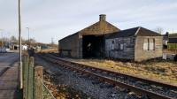 The GNSR goods shed at Keith still stands. In the foreground is the Dufftown platform line, the buffer on this line being not far behind the camera. The main Aberdeen-Inverness line is off to the left.<br><br>[David Prescott&nbsp;30/01/2018]