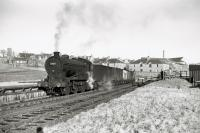Class J39 0-6-0 64590 at Inverbervie on freight to Montrose in January 1962. [Ref query 9 February 2018]<br><br>[David Murray-Smith&nbsp;27/01/1962]