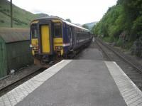 A southbound service departs from Arrochar and Tarbet on 28 May 2007 heading for Glen Douglas and the next station stop at Garelochhead.<br><br>[John McIntyre&nbsp;28/05/2007]