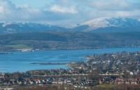 A 66 with the empties from the Lochaber Smelter drops down from Helensburgh Upper to Craigendoran. This view overlooking Helensburgh and the Gare Loch is from the east taken from close to the 'Railway Glen'. Rosneath Shipyard is in the background. The east fanlight of Helensburgh Central also features in this view, can you spot it?<br><br>[Ewan Crawford 02/02/2018]