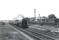 72009 <I>Clan Stewart</I> runs through the site of the original Troon station on 4 July 1959 with the 5.10pm Glasgow St Enoch - Stranraer train.<br><br>[G H Robin collection by courtesy of the Mitchell Library, Glasgow&nbsp;04/07/1959]