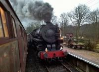 USATC 5197 makes a dramatic sight as it enters Consall station with the 16.53 to Cheddleton. The steam gala featured two American engines and one from Swindon via Aberbeeg.<br><br>[Ken Strachan 03/02/2018]