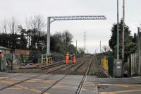 Some cabling work taking place at Carleton Crossing on 10th February 2018. This view looks toward Layton and Blackpool with a Class 66 hauled engineers train seen standing on the Up Line. The signal box stood on the left [See image  23697] for an earlier view.<br><br>[Mark Bartlett 10/02/2018]