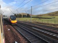 The tail end of a Virgin Pendolino disappears north (photographed from a much delayed Caledonian Sleeper waiting for it to pass in the loop at the former Abington station). <br><br>[Colin McDonald&nbsp;10/02/2018]