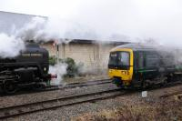 70013 <I>Oliver Cromwell</I> passes a GWR lower quadrant signal, and DMU 165108, as it leaves Moreton-in-Marsh on 10th February 2018.<br> <br> <br><br>[Peter Todd&nbsp;10/02/2018]