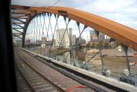 Crossing the River Irwell on the bridge carrying the Ordsall Chord on 17 February 2018, some two months after opening. Photographed from a train running between Oxford Road and Victoria on a service to Leeds via Bradford. [See image 60177]<br><br>[John McIntyre&nbsp;17/02/2018]