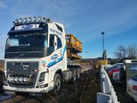 The morning of 7th February 2018 at Stonehaven, with a low loader being loaded on the former goods siding with the weekend's railway maintenance wagons before the rail/road digger loaded itself.<br> <br> <br><br>[Alan Cormack&nbsp;07/02/2018]